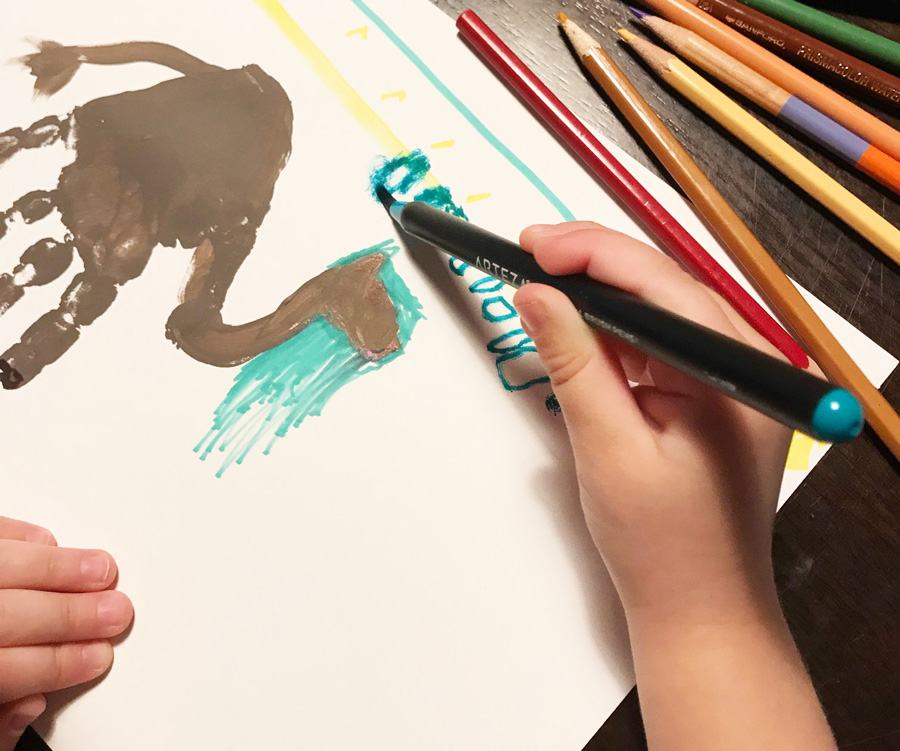 kid coloring with markers